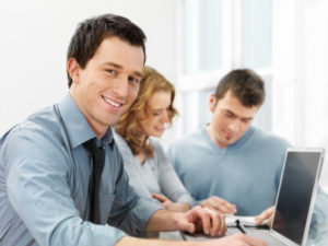 Man happily working with coworkers - compressed